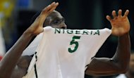 Nigeria's Ekene Ibekwe celebrates after his team defeated Dominican Republic during their pre-olympic basketball game in Caracas on July 8. Nigeria seized the last men's basketball berth at the London Olympics with an 88-73 victory over the Dominican Republic in a last-chance game at the FIBA qualifying tournament