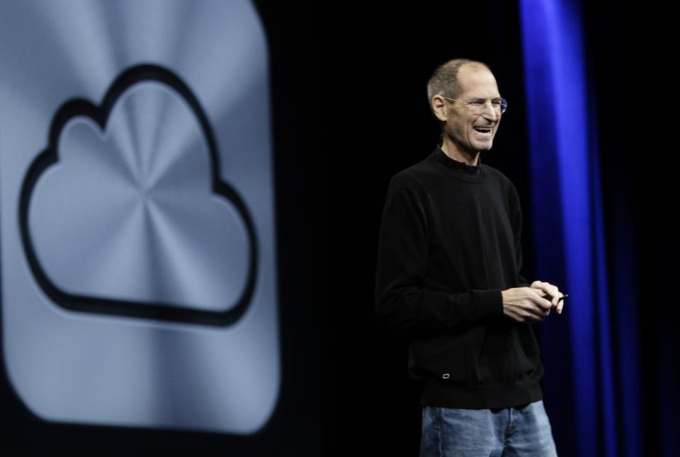 Apple CEO Steve Jobs introduces iCloud during a keynote address to the Apple Worldwide Developers Conference in San Francisco, Monday, June 6, 2011.  (AP Photo/Paul Sakuma)
