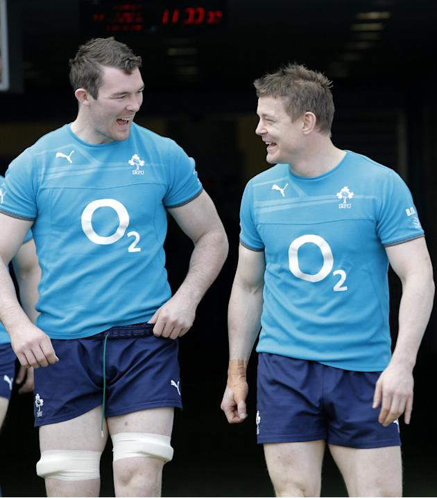 Ireland's Brian O'Driscoll, right, and Peter O'Mahony joke as they arrive for a training session at the Stade de France stadium, in Saint Denis, outside Paris, Friday, March 14, 2014. Irel