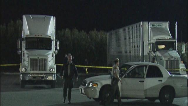 Man found dead between two trucks