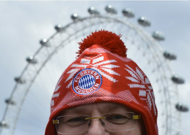 A Bayern Munich supporter walks near the London Eye in central London