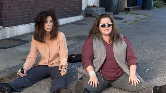 "This film publicity image released by 20th Century Fox shows Sandra Bullock as FBI Special Agent Sarah Ashburn, left, and Melissa McCarthy as Boston Detective Shannon Mullins in a scene from ""The Heat."" (AP Photo/20th Century Fox, Gemma La Mana)"