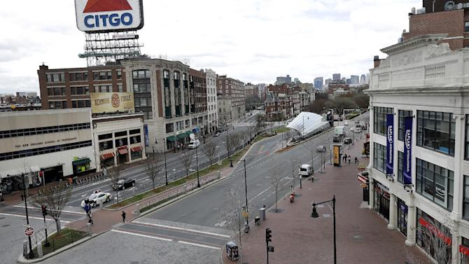 """The usually busy Kenmore Square in Boston is virtually deserted at lunchtime Friday, April 19, 2013, during a call for """"shelter-in-place"""" for Boston and some area communities. Two suspects in the Boston Marathon bombing killed an MIT police officer, injured a transit officer in a firefight and threw explosive devices at police during their getaway attempt in a long night of violence that left one of them dead and another still at large Friday, authorities said as the manhunt intensified for a young man described as a dangerous terrorist. (AP Photo/Elise Amendola)"""