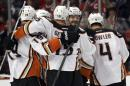 Anaheim Ducks defenseman Simon Despres, second from right, celebrates a goal with his teammates during the second period of Game 3 of the Western Conference finals against the Chicago Blackhawks of the NHL hockey Stanley Cup playoffs, Thursday, May 21, 2015, in Chicago. (AP Photo/Nam Y. Huh)