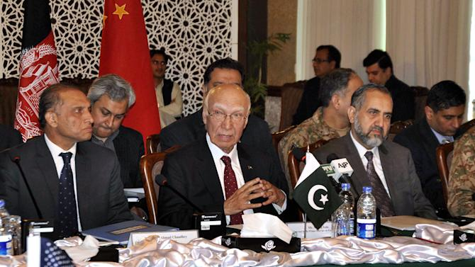 In this photo released by Associated Press of Pakistan, Sartaj Aziz, center, adviser to the Pakistani prime minister on foreign affairs, speaks during the third round of a meetings at the foreign ministry in Islamabad, Pakistan, Saturday, Feb. 6, 2016. China, the United States, Afghanistan and Pakistan launched their third round of talks Saturday aimed at finding a way to get the warring Taliban to sit and talk peace with the Afghan government. (Associated Press of Pakistan via AP)