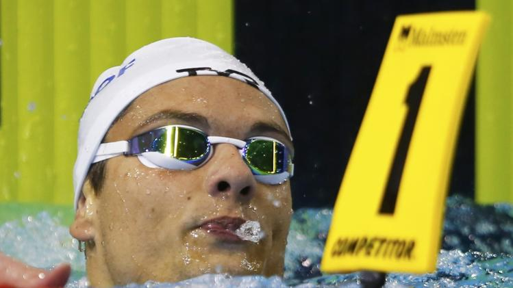 Maudou of France reacts after the men's 100m freestyle semi-final at the European Swimming Championships in Berlin
