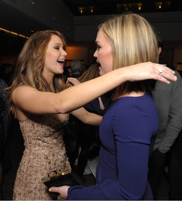 Jennifer Lawrence, left, and Julia Stiles attend The Hollywood Reporter Nominees' Night at Spago on Monday, Feb. 4, 2013, in Beverly Hills, Calif. (Photo by John Shearer/Invision for The Hollywood Rep