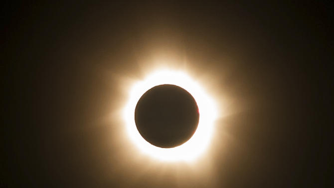 In this photo provided by Tourism Queensland, the moment of a total solar eclipse is observed at Cape Tribulation in Queensland state, Australia, Wednesday, Nov. 14, 2012. Starting just after dawn, the eclipse cast its 150-kilometer (95-mile) shadow in Australia's Northern Territory, crossed the northeast tip of the country and was swooping east across the South Pacific, where no islands are in its direct path. (AP Photo/Tourism Queensland) EDITORIAL USE ONLY