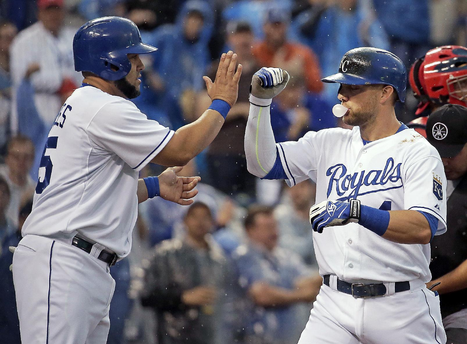 Gordon, Volquez lead KC over Cards in rain-shortened game