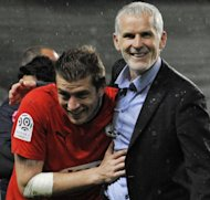 Bordeaux' goalkeeper Cedric Carrasso (L) is congratulated by coach Francis Gillot at the end of their French Ligue 1 match against Saint Etienne, on May 20, at the Geoffroy Guichard stadium in Saint Etienne. Bordeaux won 3-2