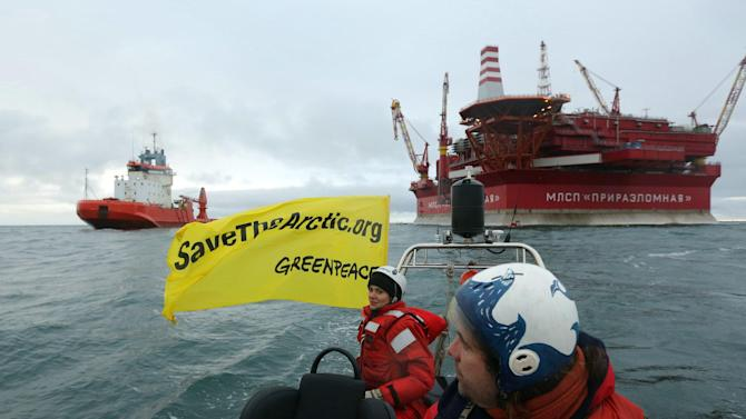 Greenpeace activists are in a boat in front of  energy giant Gazprom's Arctic oil platform Prirazlomnaya in the Pechora Sea on Friday, Aug. 24, 2012. Greenpeace activists have stormed a floating oil rig in Russia's Pechora Sea, hundreds of miles (kilometers) from the nearest port, to protest oil drilling in the Arctic, the environmental organization said Friday. (AP Photo/Denis Sinyakov, Greenpeace)