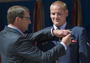 Secretary of Defense Ashton Carter presents the Airman's …