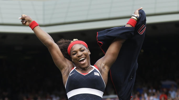 In this Saturday, Aug. 4, 2012 photo, United States' Serena Williams celebrates after defeating Maria Sharapova of Russia to win the women's singles gold medal match at the All England Lawn Tennis Club at Wimbledon, in London, at the 2012 Summer Olympics. (AP Photo/Victor R. Caivano)