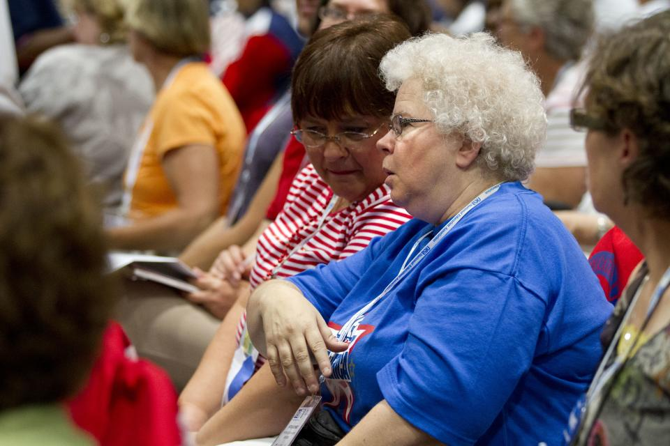 Patricia Schmidt, an elementary teacher from Wautoma, Wisc., right, attends the National Education Association's annual convention in Washington, on Thursday, July 5, 2012. (AP Photo/Jacquelyn Martin)