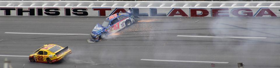 Bobby Labonte (47)  hits the wall in Turn 2 during the NASCAR Sprint Cup Series auto race at Talladega Superspeedway in Talladega, Ala., Sunday, Oct. 23, 2011. At left is Kurt Busch. (AP Photo/Dave Martin)