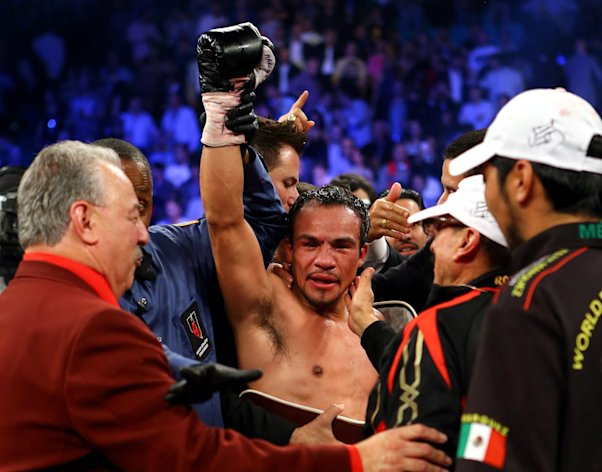 LAS VEGAS, NV - DECEMBER 08: Juan Manuel Marquez celebrates after defeating Manny Pacquiao by a sixth round knockout in their welterweight bout at the MGM Grand Garden Arena on December 8, 2012 in Las Vegas, Nevada. (Photo by Al Bello/Getty Images)