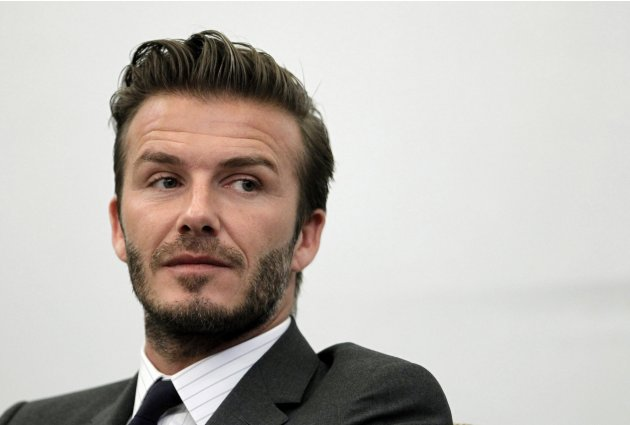 Former England soccer captain David Beckham addresses a news conference in Shanghai