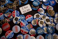 US President Barack Obama campaign buttons are seen for sale at a campaign event in Oakland, California, on July 23