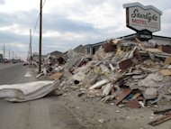 FILE - In this Jan. 4, 2012 file photo, huge piles of debris still line portions of Route 35, the main highway through the shore in Toms River N.J. In New Jersey, 346,000 housing units were destroyed or damaged, and 190,000 businesses affected. Loss estimates in the affected states vary. Earlier this month, leading insurance company Munich Re Ag estimated insured losses at $25 billion and total losses at $50 billion. In December, state governments reported a total of $62 billion in damage and other losses. (AP Photo/Wayne Parry, File)