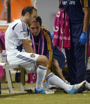 Los Angeles Galaxy's Landon Donovan, left, sits on the bench after injuring his leg during the second half of an MLS soccer match against Real Salt Lake, Saturday, Oct. 6, 2012, in Carson, Calif. Real Salt Lake won 2-1. (AP Photo/Mark J. Terrill)