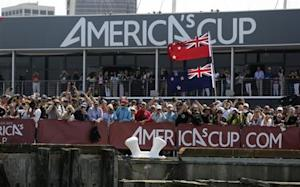 Fans of Emirates Team New Zealand Oracle cheer after they defeated Team USA during Race 5 of their 34th America's Cup yacht sailing race in San Francisco