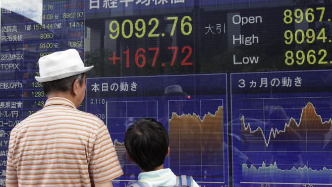 A man and a child look at a securities firm's electronic stock board in Tokyo Thursday, Aug. 16, 2012. Japan's Nikkei 225 index rose 1.88 percent to 9,092.76 Thursday as Asian stock markets were mostly higher after comments from Chinese Premier Wen Jiabao added to hopes for more action to spur the world's No. 2 economy. (AP Photo/Shizuo Kambayashi)