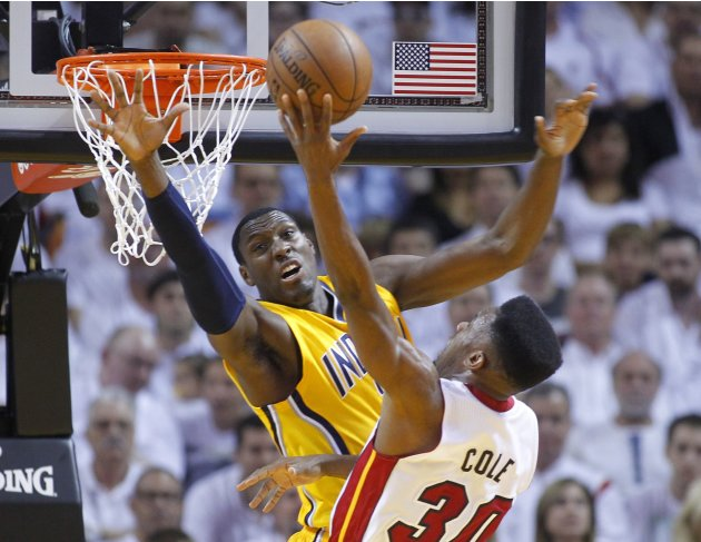Indiana Pacers Ian Mahinmi defends as Miami Heat's Norris Cole goes up to shoot during Game 1 of their NBA Eastern Conference final basketball playoff in Miami