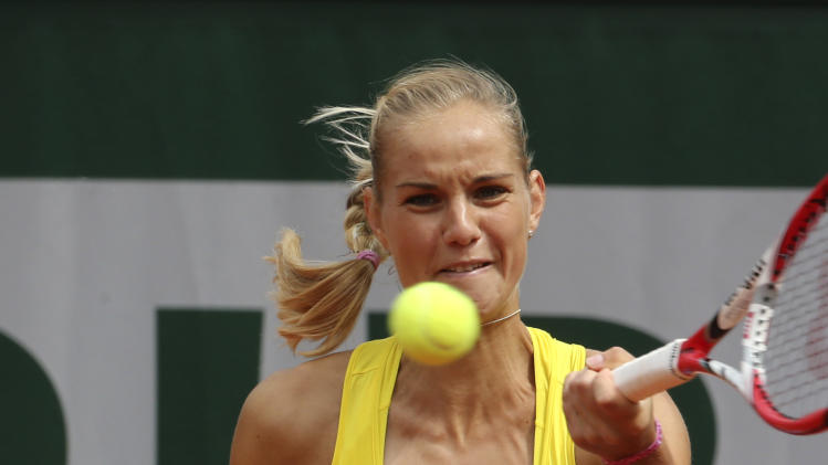 Arantxa Rus, of The Netherlands, returns the ball to Italy's Sara Errani during their first round match of the French Open tennis tournament at the Roland Garros stadium Sunday, May 26, 2013 in Paris. (AP Photo/Michel Euler)