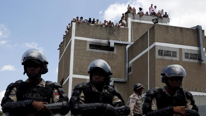 Inmates gather on the roof of the prison of the National Bolivarian Police during a riot in Caracas