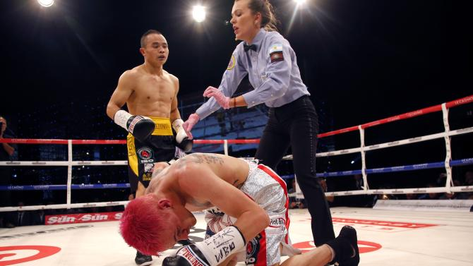 Budler of South Africa falls during their WBA-IBO minimumweight world championship fight against Xiong Zhao Zhong of China in Monaco