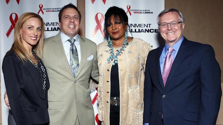 Marlee Matlin, Chris Long, Senior Vice President, Entertainment & Production at DIRECTV, Pam Grier and David Bishop, President Sony Pictures Home Entertainment are seen at the Visionary Awards benefiting the Entertainment AIDS Alliance, on Wednesday, Nov. 14, 2012 in Los Angeles. (Photo by Todd Williamson/Invision for the Entertainment AIDS Alliance/AP Images)