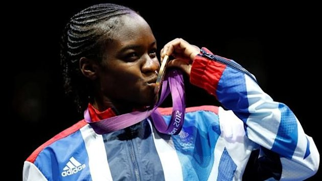 Britain's Nicola Adams kisses her gold medal after defeating China's Ren Cancan during their Women's Fly (51kg) gold medal boxing match at the London Olympic Games (Reuters)
