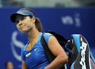 "Li Na leaves court after her women's singles semi-final against Maria Sharapova at the China Open tournament in the National Tennis Center of Beijing, on October 6. Li has insisted ""age is nothing"" and put retirement talk on hold as she eyes next season with rising confidence after a resurgence she credits to her new coach, Carlos Rodriguez"
