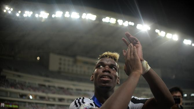 Juventus midfielder Paul Pogba celebrates his team's victory after the Italian Super Cup final against Lazio in Shanghai on August 8, 2015