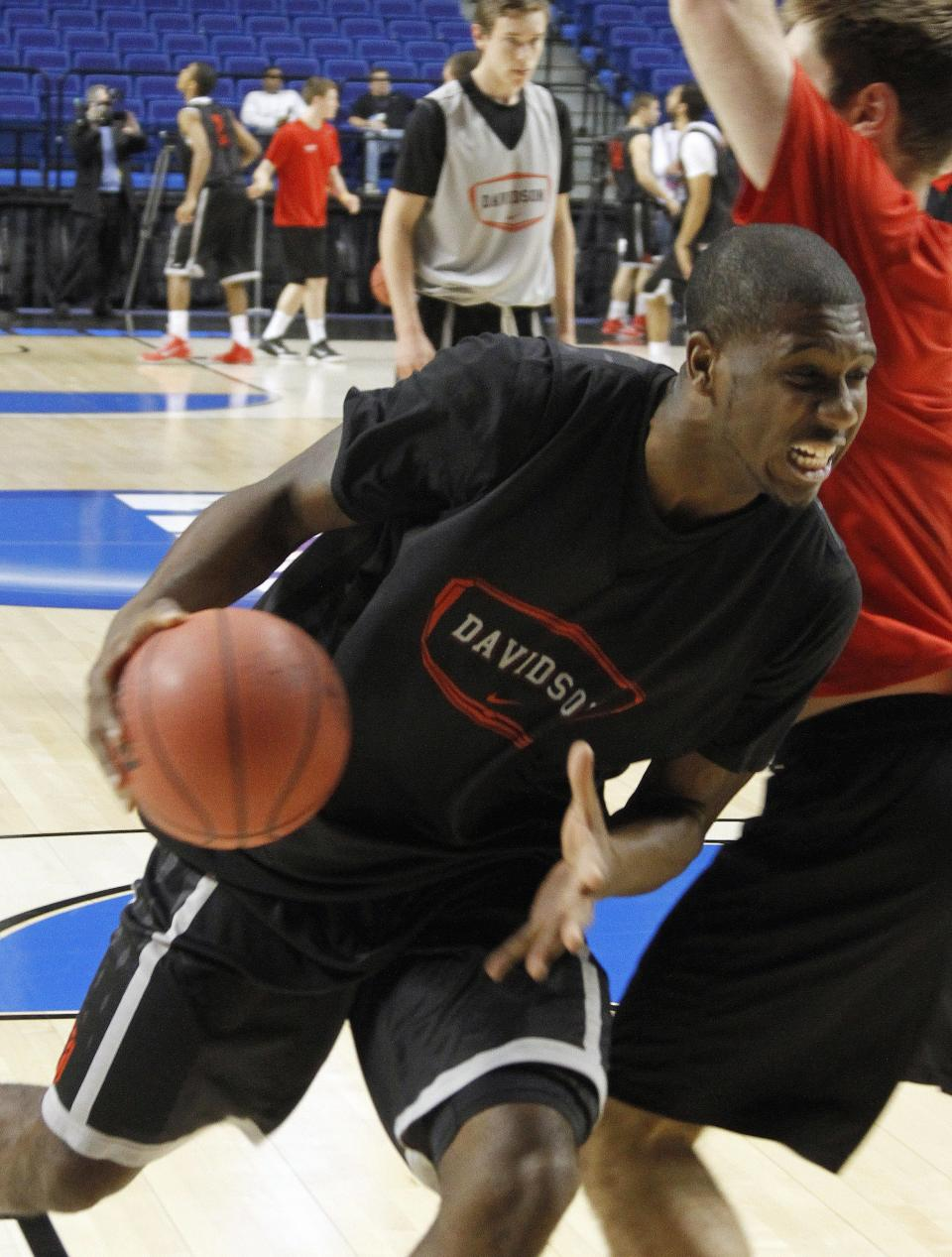 Davidson forward De'Mon Brooks drives during practice for the second round of the NCAA college basketball tournament Wednesday, March 20, 2013, in Lexington, Ky. Davidson will play Marquette Thursday. (AP Photo/James Crisp)