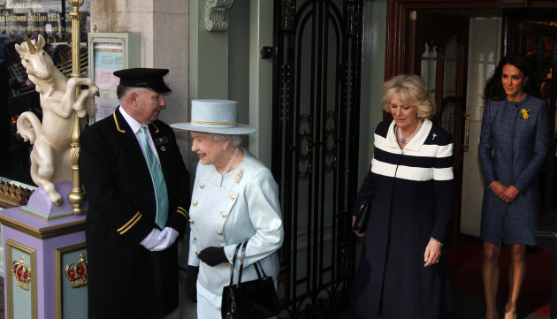 Britain&#39;s Queen Elizabeth II, left, Camilla, Duchess of Cornwall, centre, and Kate, Duchess of Cambridge walk outside the Fortnum and Mason department store for a ceremony to unveil a plaque to commemorate the regeneration of Piccadilly in central London, Thursday, March, 1, 2012. (AP Photo/Alastair Grant)