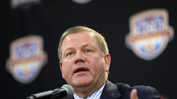 Notre Dame head coach Brian Kelly speaks during a news conference for the BCS National Championship college football game Sunday, Jan. 6, 2013, in Miami. (AP Photo/David J. Phillip)