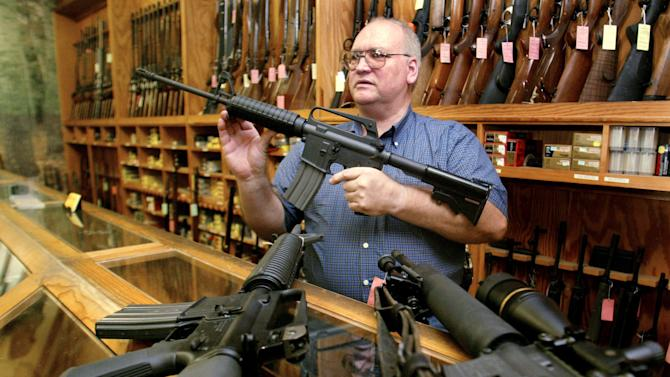 Dallas Texas gun dealer displays assault style rifles inside Texas gun store.