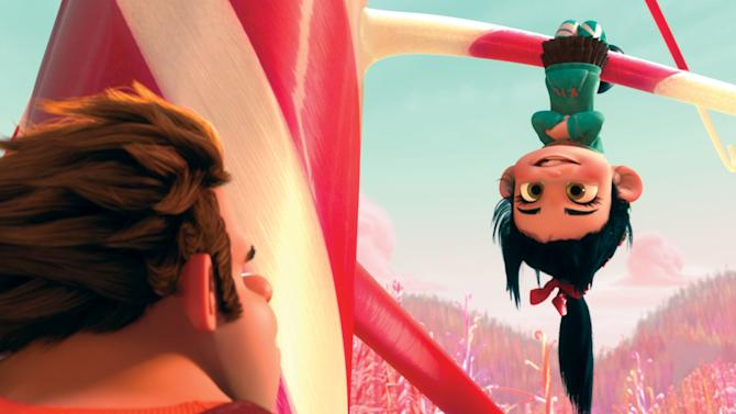 """This film image released by Disney shows Ralph, voiced by John C. Reilly, left, and Vanellope Von Schweetz, voiced by Sarah Silverman in a scene from """"Wreck-It Ralph."""" (AP Photo/Disney)"""