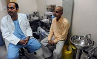 Cancer patient Brijender Singh (R), pictured after being examined by doctor Pankaj Chaturvedi during a routine check-up at the Tata Memorial Hospital in Mumbai. India has 75,000 to 80,000 new cases of oral cancer a year, highest rate in the world, caused by a popular chewing tobacco that doctors say is fuelling the epidemic