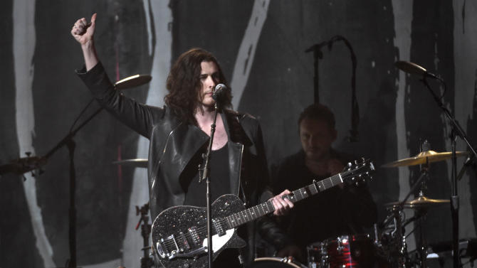 "FILE - In this Sunday, May 17, 2015 file photo, Hozier performs at the Billboard Music Awards at the MGM Grand Garden Arena in Las Vegas. Hozier, Nick Jonas and Trey Songz are among the performers set for the daytime portion of the upcoming iHeartRadio Festival. Swedish singer Tove Lo, pop-rock band Echosmith and Walk the Moon, who have a massive hit with ""Shut Up and Dance,"" will also perform on Sept. 19, 2015, for the Daytime Village at the MGM Resorts Village in Las Vegas.  (Photo by Chris Pizzello/Invision/AP, File)"