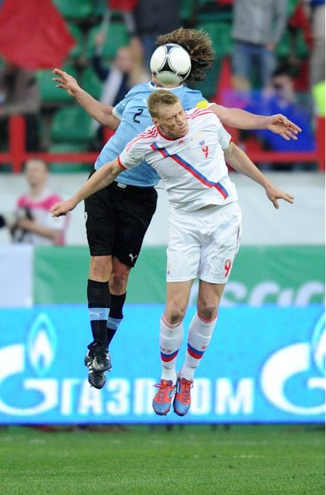 Russia's Pavel Pogrebnyal (R) Vies AFP/Getty Images