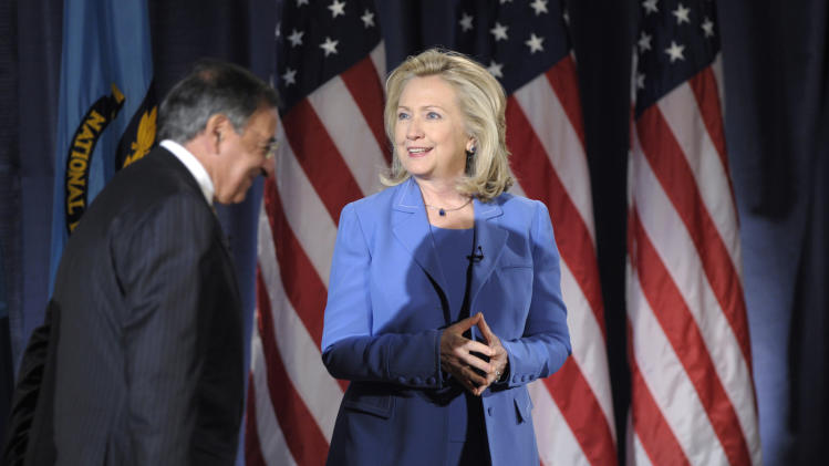 Secretary of State Hillary Rodham Clinton and Defense Secretary Leon Panetta arrive for an event at the National Defense University in Washington, Tuesday, Aug. 16, 2011. (AP Photo/Susan Walsh)