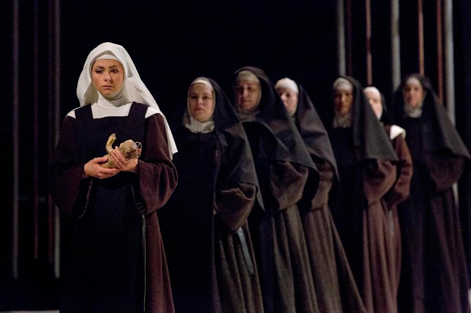"In this April 26, 2013 photo provided by the Metropolitan Opera, Isabel Leonard as Blanche de la Force leads a procession in Poulenc's ""Dialogues des Carmélites,"" during a dress rehearsal at the Metropolitan Opera in New York. (AP Photo/Ken Howard)"
