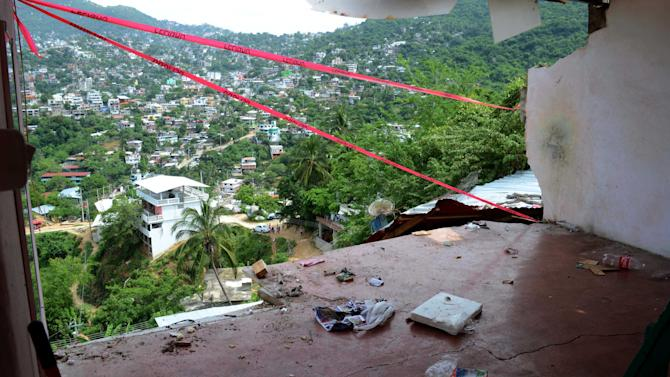 The wall of a home is missing after it fell during an earthquake in Acapulco, Wednesday, Aug. 21, 2013. The U.S. Geological Survey said the quake had a magnitude of 6.2 and was centered on the Pacific coast, near the resort of Acapulco. (AP Photo/Bernardino Hernandez)