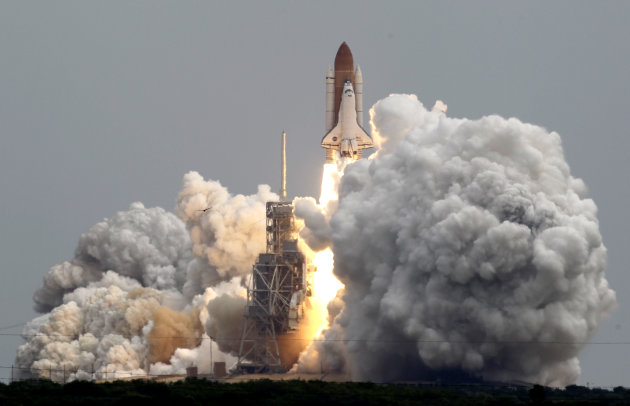 Space shuttle Atlantis lifts off from Pad 39A at the Kennedy Space Center in Cape Canaveral, Fla., Friday, July 8, 2011