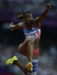 Colombia's Caterine Ibarguen competes in the women's triple jump final at the athletics event during the London 2012 Olympic Games on August 5, 2012 in London. AFP PHOTO / ADRIAN DENNIS