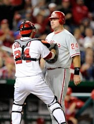 Washington Nationals&#39; Kurt Suzuki (L) tags out Philadelphia Phillies&#39; Ty Wigginton to end the fourth inning on October 1. &quot;The last couple weeks have been tough. It has gotten us ready for the post-season. I&#39;m excited and really looking forward to it,&quot; Suzuki said