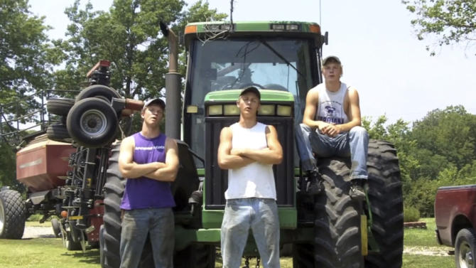 """This frame grab from video shows Assaria, Kan., brothers, from left: Nathan; Greg and Kendal Peterson in their video parody on LMAFO's """"Sexy and I Know It.""""  The parody, that has gone viral on YouTube and Facebook, shows the three brothers rapping their farming mission on the family's Saline County farm. (AP Photo/Courtesy Greg Peterson)"""