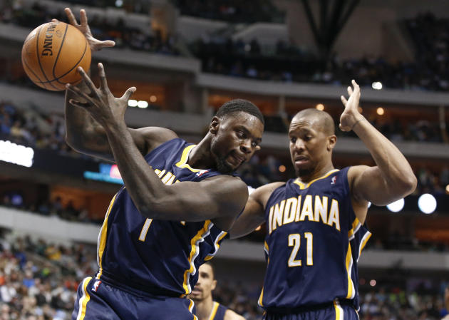 Indiana Pacers shooting guard Lance Stephenson (1) rebounds the ball in front of power forward David West (21) during the first half of an NBA game against the Dallas Mavericks, Sunday, March 9, 2014,